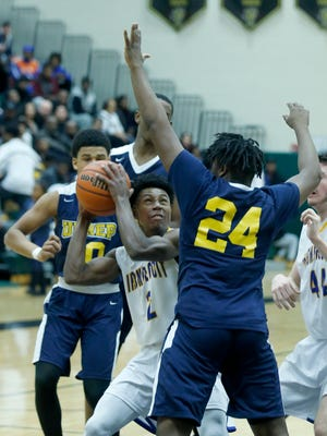 Irondequoit's Ty'Sean Sizer looks for an opening as University Prep's Joe McGrady sets up a block in the second quarter at Rush-Henrietta High School.