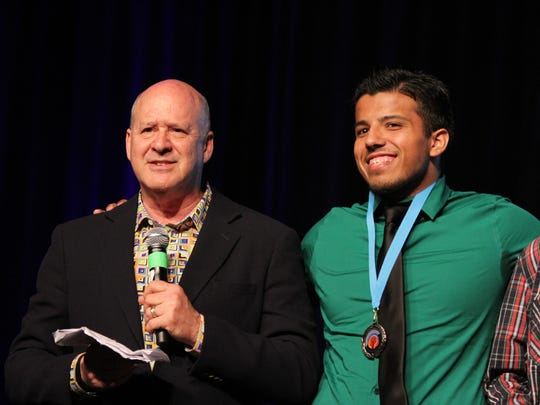 DIGICOM CEO David Vogel, left, helps announce the awards for students such as filmmaker Erick Medina, right, of Cathedral City High School during The 2016 DIGICOM Film Festival held at the Palm Springs Convention Center in Palm Springs on Tuesday, May 3, 2016.
