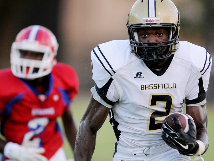 Seminary's Tyre Jones, left, tries to catch Bassfield's Jamal Peters Friday during their game at Seminary.