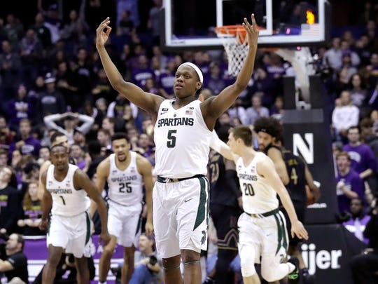 Michigan State guard Cassius Winston (5) reacts after making a 3-point basket against Northwestern during the second half of MSU's 65-60 win on Saturday, Feb. 17, 2018, in Rosemont, Ill.