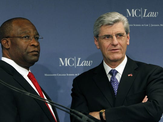 Republican candidate Phil Bryant, right, and Democrat candidate Johnny DuPree wait for the start of their gubernatorial debate at the Mississippi College School of Law auditorium on Oct. 14, 2011.