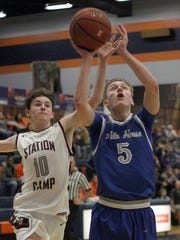 Station Camp's Eli Thurston moves in from behind as