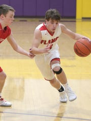 Mansfield Christian's Kyle Kurtz dribbles the ball down the court while playing in sectionals at Lexington High School on Tuesday.