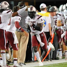 South Carolina Gamecocks safety Brison Williams (12) celebrates after returning an interception for a touchdown.