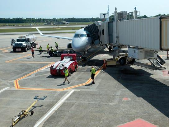Ground crews at Pensacola International Airport prepare