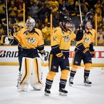 Nashville Predators center Mike Fisher (12) and goalie Pekka Rinne (35) celebrate after Fisher\s game winning goal during overtime in Game 4 in an NHL hockey Western Conference semifinal series at the Bridgestone Arena, Friday, May 6, 2016, in Nashville, Tenn.