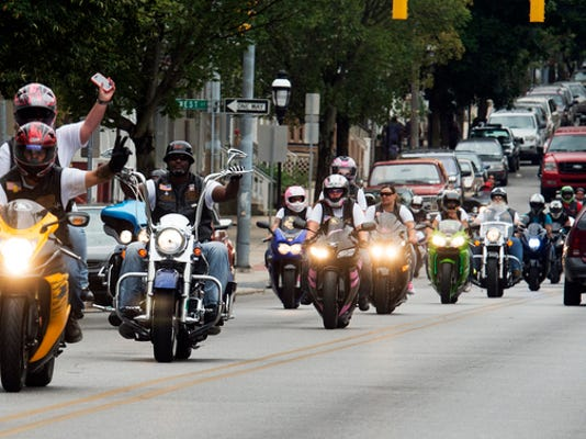Riders head east on West Princess Street during the fourth annual Stop the Violence bike ride event Sunday.