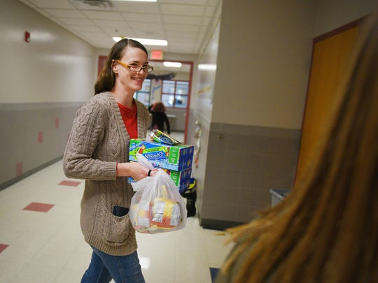 PTA member at Terry Redlin Elementary School Kristina Williams takes Goldfish and Capri Suns to classrooms Friday, Oct. 27, at the elementary school. The PTA is in charge of delivering snacks to each classroom for holiday parties. The students were having halloween parties in their classrooms.