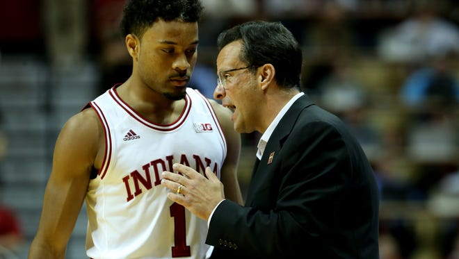 Indiana Hoosiers head coach Tom Crean talks with Indiana Hoosiers guard James Blackmon Jr. (1) during a free throw opportunity by the IPFW Mastodons at Assembly Hall on Dec. 9, 2015.