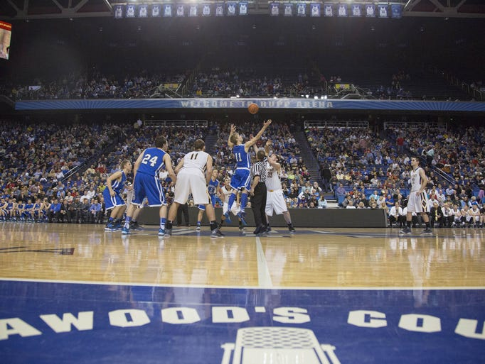 Covington Catholic tips off against Clay County in Rupp Arena on March 20 in the 2014 Whitaker Bank/KHSAA Boys' Sweet 16 State Tournament.
