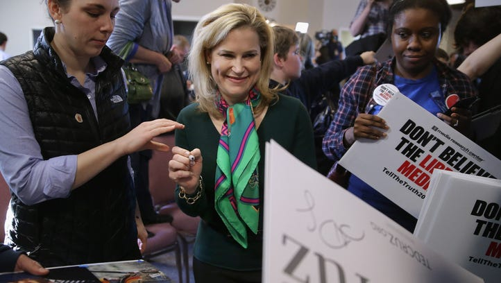 WINDHAM, NH - FEBRUARY 02:  Heidi Cruz, wife of Republican presidential candidate Sen. Ted Cruz (R-TX), autographs campaign posters following a town hall meeting with her husband at the Crossing Life Church February 2, 2016 in Windham, New Hampshire. Cruz emerged at the top of a crowded GOP presidential field after winning Monday's Iowa caucuses.  (Photo by Chip Somodevilla/Getty Images)