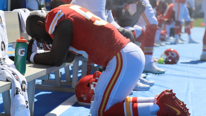 Justin Houston of the Chiefs takes a knee during the