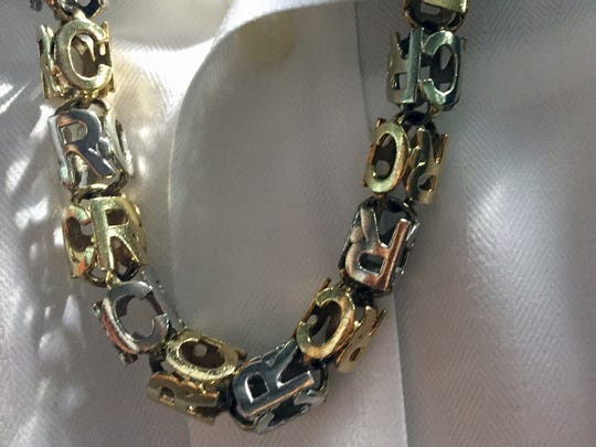 A necklace is worn by Seattle Mariners All-Star second baseman Robinson Cano at Minute Maid Park in Houston on Wednesday, July 6, 2016. Cano is supremely fashion-conscious, and he talks with joy about the collection in his massive closet.