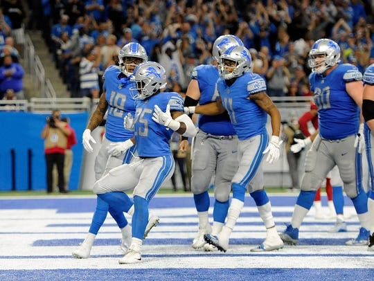 Detroit Lions running back Theo Riddick (25) celebrates