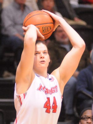 Marist College's Tori Jarosz attempts a shot against Temple in a WNIT game on Thursday at McCann Arena.