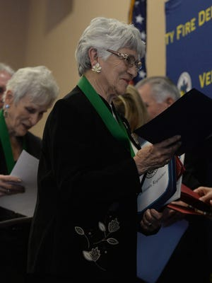 Sylvia Fulton, with Jane Wolny behind her,  receives a medal for a rescue during a house fire last year at Leisure Village in Camarillo. The Ventura County Fire Department held its  21st annual awards ceremony Thursday at the Serra Center of Padre Sierra Church in Camarillo.