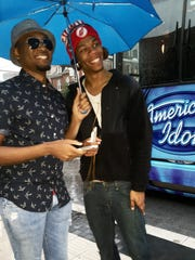 """Lonnie Bails (left), 22, and Corie Easley, 20, both of Indianapolis, wait to audition for """"American Idol,"""" Thursday, June 25, 2015."""
