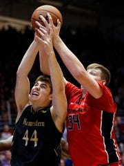 Northwestern forward Gavin Skelly, left, battles for a rebound against Rutgers center C.J. Gettys during the second half of a game Saturday, Feb. 18, 2017, in Evanston, Ill. Northwestern won 69-65.