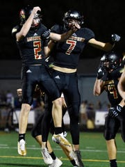 Ravenwood's Connor Patton (7) celebrates his touchdown