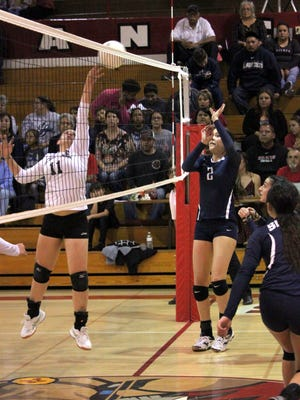 Cobre's Amaya Jacquez touches this ball over the net during action Thursday night. She had five kills to pace the Lady Indians.