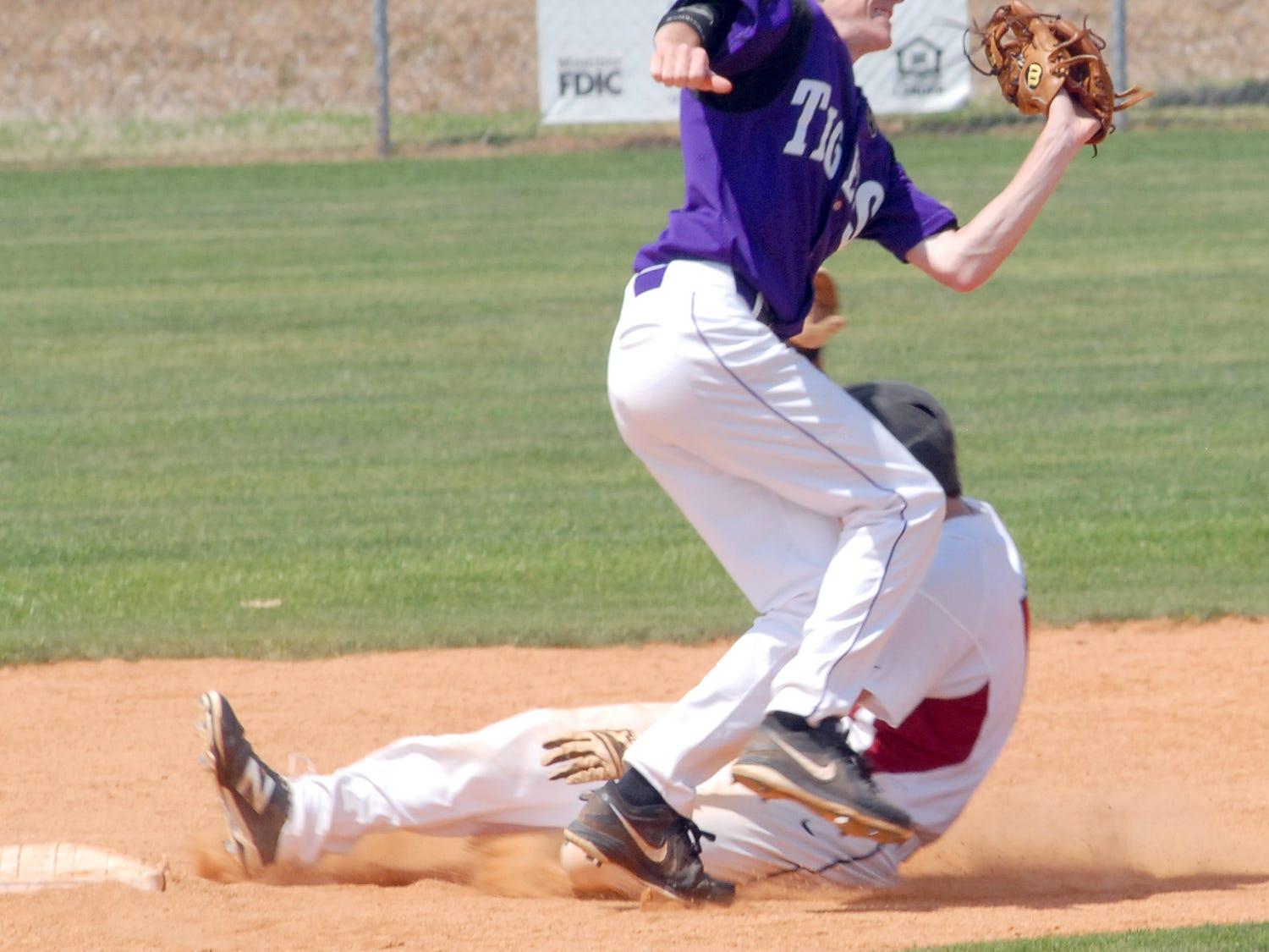 Crockett County's Sloan Leath slides safely into second base against Ripley in a Class AA sectional.
