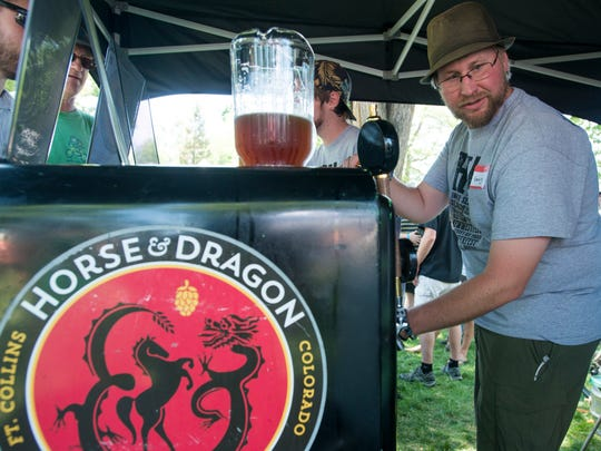 Horse & Dragon Brewing Co. pouring at past Colorado Brewers Festival.
