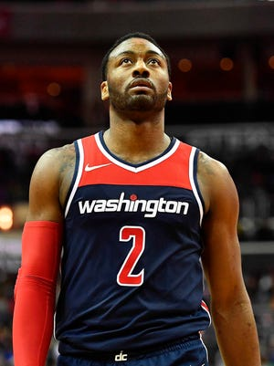 Washington Wizards guard John Wall on the court against the Brooklyn Nets during the second half at Capital One Arena.