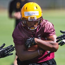 Running back Kyle Middlebrooks runs the ball during practice at Arizona State, Thursday, April 17, 2014.