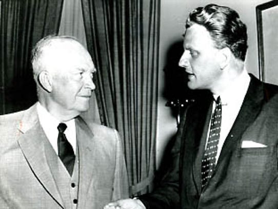 Evangelist Billy Graham talks with President Dwight