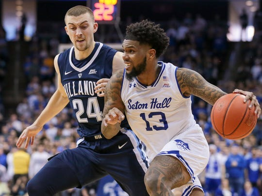 Mar 9, 2019; Newark, NJ, USA; Seton Hall Pirates guard Myles Powell (13) dribbles the ball as Villanova Wildcats guard Joe Cremo (24) defends during the seance half at Prudential Center. Mandatory Credit: Vincent Carchietta-USA TODAY Sports
