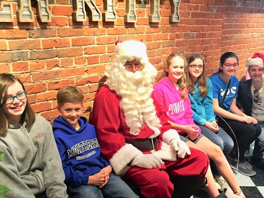 Birthday Fun – A birthday celebrant and her friends stopped by River Kitty prior to lunching at Comfort for a quick cuddle and photo op with Santa Paws. Pictured are Abby Greenwell, Willian Nicholls, Santa, the birthday girl Elena Nicholls, Riley Weber, Cydney Wathen and Robert Nicholls.