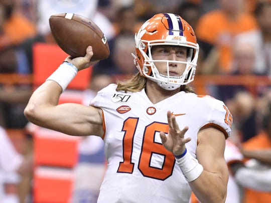 Sep 14, 2019; Syracuse, NY, USA; Clemson Tigers quarterback Trevor Lawrence (16) throws a pass during the second quarter against the Syracuse Orange at the Carrier Dome. Photo Credit: Mark Konezny - USA TODAY Sports