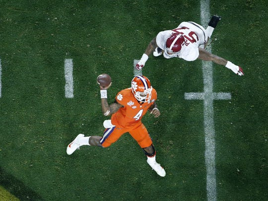 AP Clemson's Deshaun Watson (4) throws while being rushed by Alabama's D.J. Pettway (57) during the second half of Monday?s championship game. Clemson's Deshaun Watson (4) throws while being rushed by Alabama's D.J. Pettway (57) during the second half of the NCAA college football playoff championship game Monday, Jan. 11, 2016, in Glendale, Ariz. (AP Photo/Ross D. Franklin)