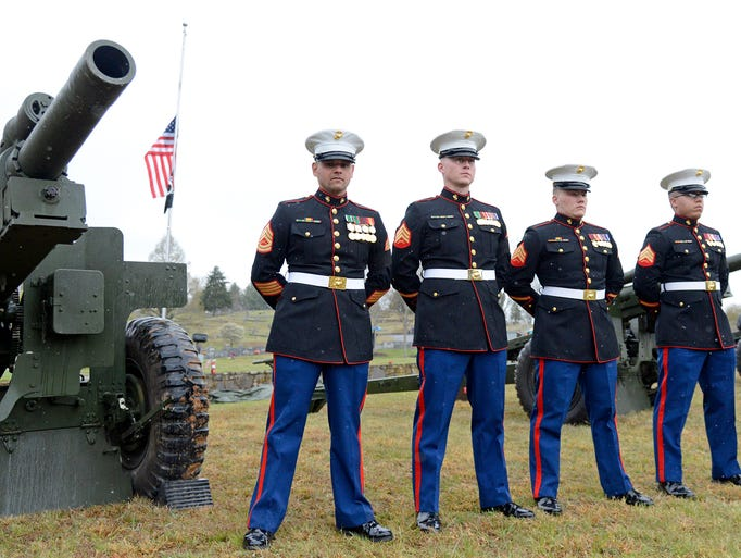 General Carl Epting Mundy, Jr. was laid to rest at Green Hill Cemetery in Waynesville Saturday. The Marine Corps performed a miltary tribute to the general with a march down Main Street, a 19 gun salute from the Presidential Salute Team from Quantico, Va., and a flyover by four Osprey helicopters. General Mundy fought in Vietnam with the 3d Battalion, 26th Marines at Khe Sanh and Con Thien and was appointed to serve as the 30th Commandant of the Marine Corps from 1991 to 1995. 4/19/14. Robert Bradley (rbradley@citizen-times.com)