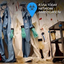 Biohazard suits hang inside a biosafety level 4 laboratory suite at the U.S. Army Medical Research Institute of Infectious Diseases in Fort Detrick, Md., in 2011. The BSL-4 lab, which is the the highest security-level lab possible, is used for handling deadly pathogens that have no vaccine or cure.