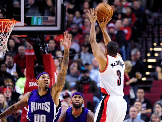 Portland Trail Blazers guard C.J. McCollum (3) shoots over Sacramento Kings center Willie Cauley-Stein (00) during the first half of an NBA basketball game in Portland, Ore., Tuesday, Jan. 26, 2016.