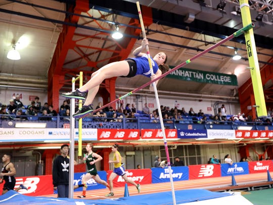 Julia Tucci, of Demarest, clears the pole vault during