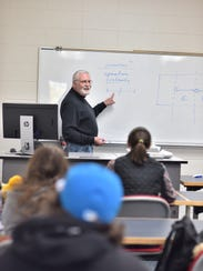 UW-Manitowoc professor Dr. Alan White in the classroom