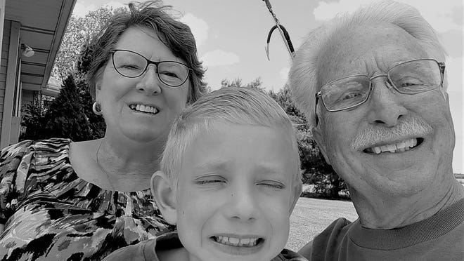 Rider, center, with his grandparents Debbie and Larry Barnes. Photo provided.