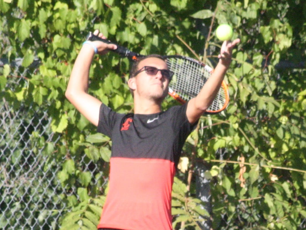 Churchill's No. 4 singles player Peyton Elkins delivers a serve during Monday's match against Farmington.