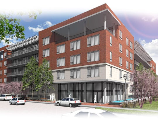 An artist's rendering shows a 140-unit apartment building