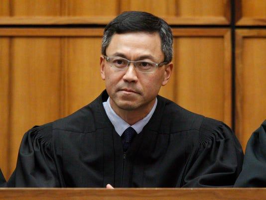 District Judge Derrick Watson