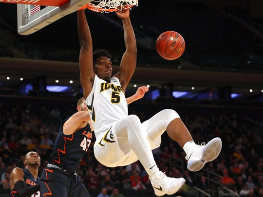 Iowa Hawkeyes forward Tyler Cook (5) dunks against Illinois Fighting Illini forward Michael Finke (43) during the first half of a first round game of the 2018 Big Ten Tournament at Madison Square Garden.