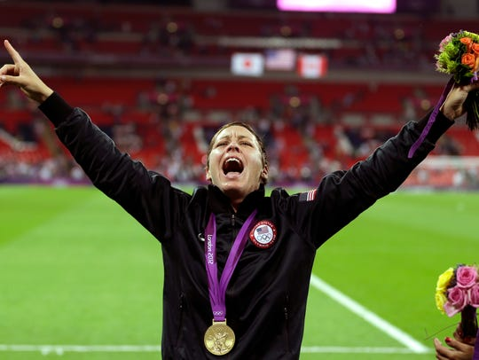 Abby Wambach celebrates winning the gold medal at the