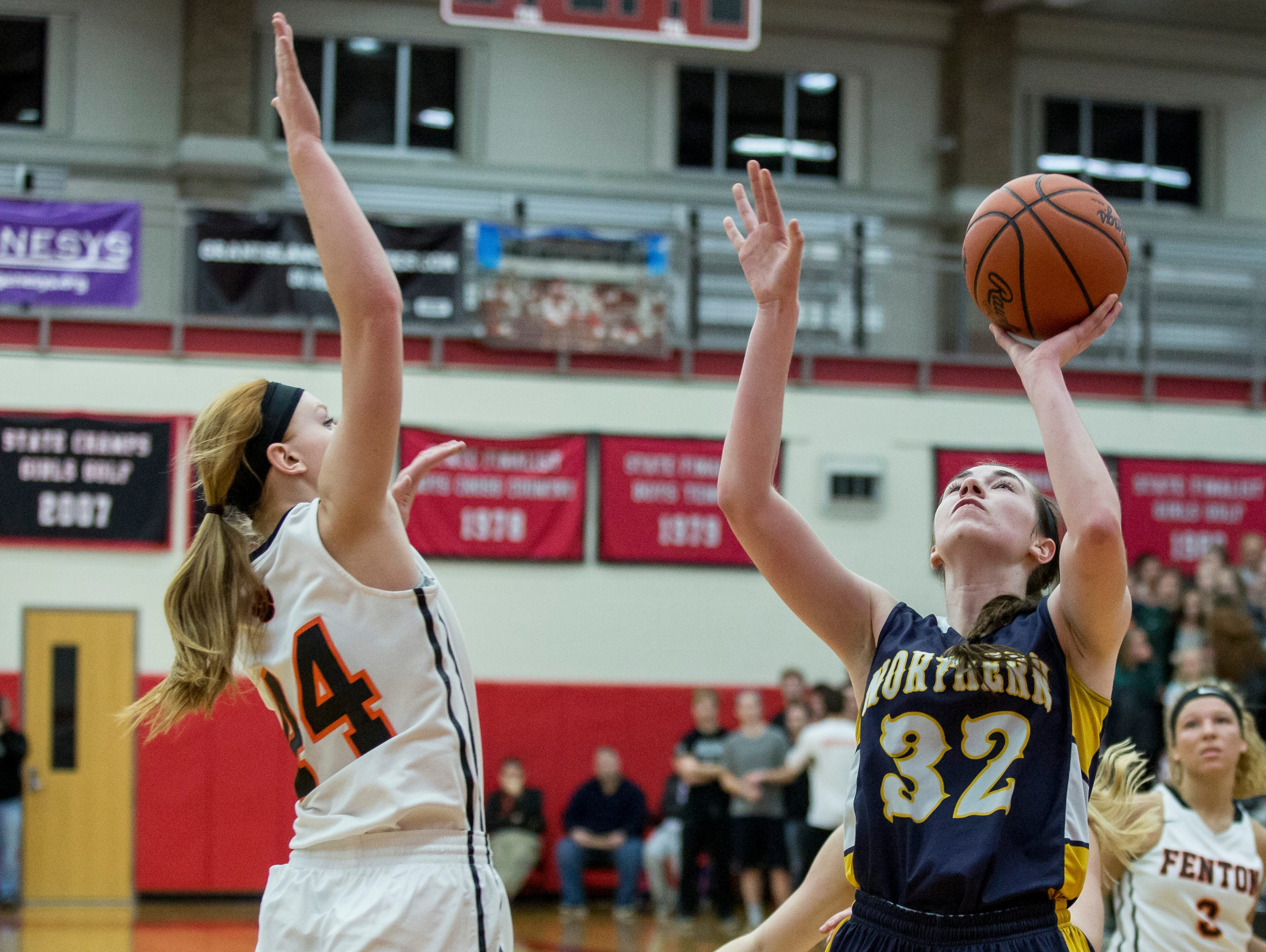 Port Huron Northern junior Bree Bauer takes a shot during a regional final basketball game Thursday, March 10, 2016 at Grand Blanc High School.
