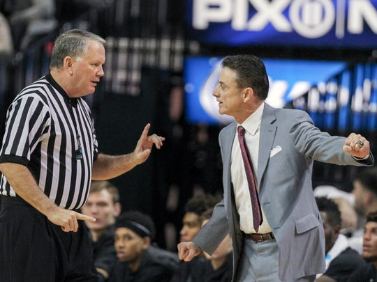 Nov 28, 2015; Brooklyn , NY, USA; Louisville Cardinals head coach Rick Pitino argues with a referee in his game against the Saint Louis Billikens at Barclays Center. Mandatory Credit: Vincent Carchietta-USA TODAY Sports