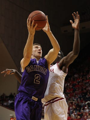 Dec. 13, 2014: Grand Canyon guard Josh Braun (2) shoots the ball with Indiana Hoosiers forward Hanner Mosquera-Perea defending during the second half at Assembly Hall.