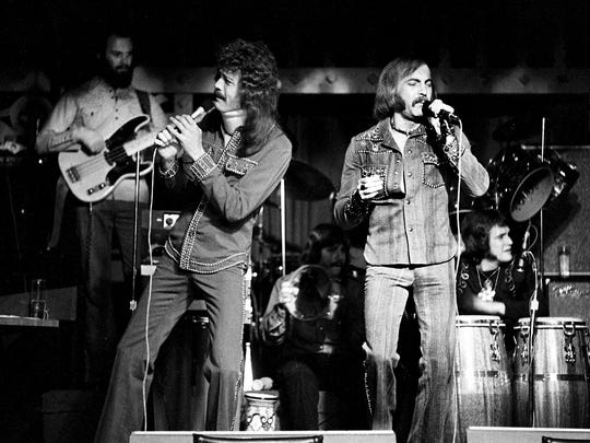 Don Sumner, front left, and Sean Nielsen, front right, perform for their fans at The Villa at 1711 Hayes St. in Nashville on March 1, 1975. The group has being an opening act and backup band for Elvis Presley for a year and a half and will join Presley in Las Vegas later in the month.