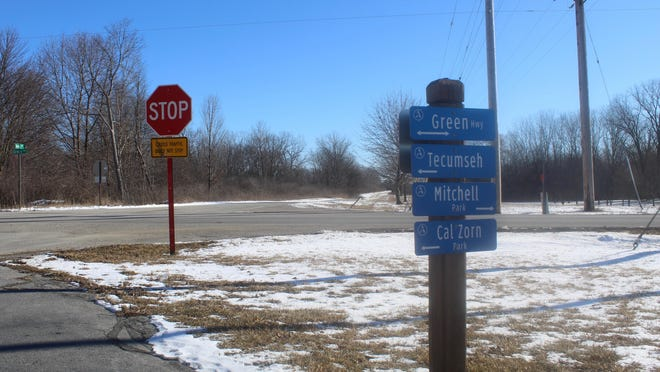 Directional signs at the end of the Kiwanis Trail are pictured Wednesday. A 1 1/2-mile extension to the Kiwanis Trail will take the recreational path into the city of Tecumseh. The extension will follow Ives Road to Raisin Center Highway and end at Cal Zorn Recreation Center.