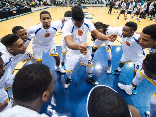 Wicomico High guard Nelson Brown (20) amps up his teammates